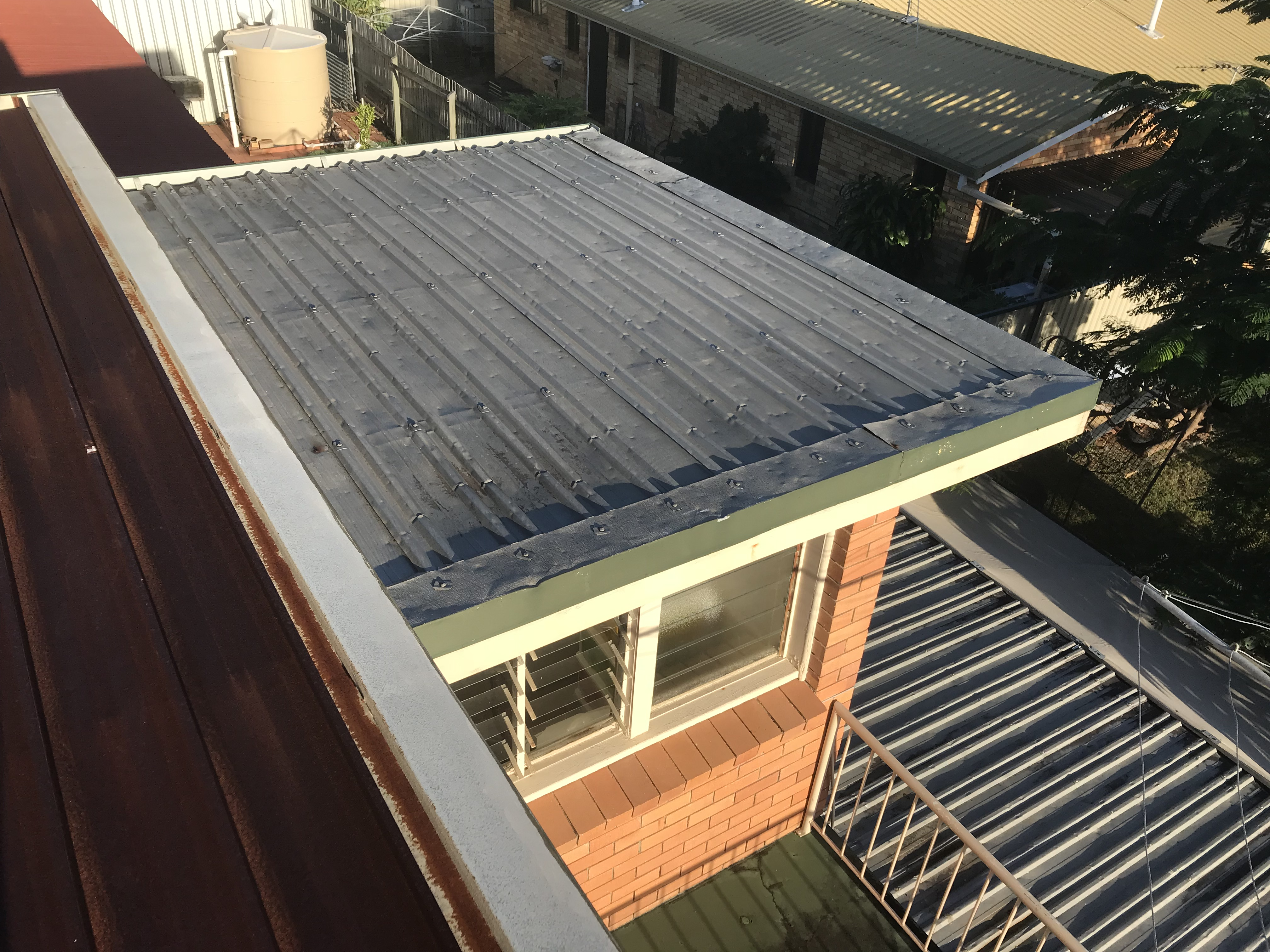 Flat roof with hail damage in brisbane