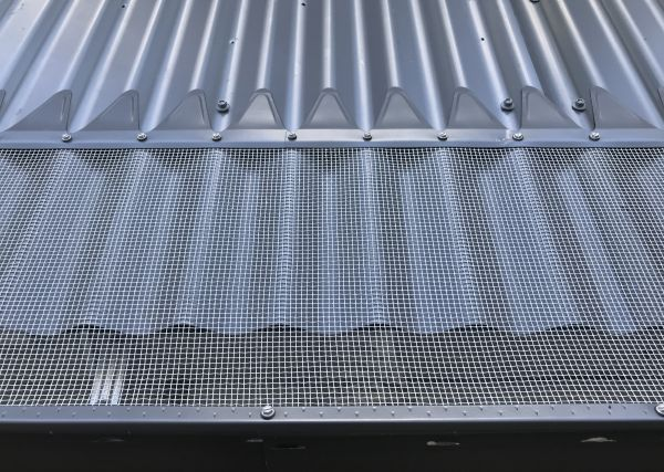 Blue Mountain Mesh Gutter Guard installed on corrugated metal roof