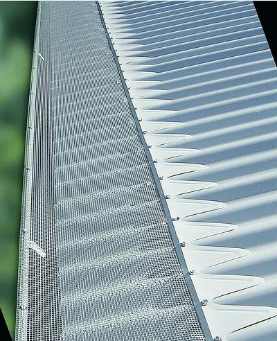 Blue mountain mesh gutter guard installed to gutters on metal roof