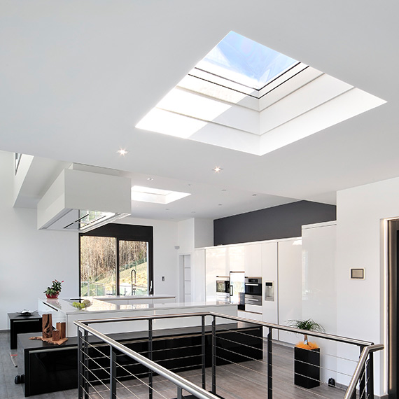 View of interior of home with large skylights and natural light