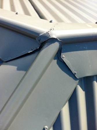 Poorly installed ridge capping, untidy cuts and gaps