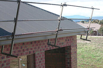House with on-roof edge rail installed to perimeter