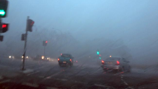 Rain storm blurred windscreen view
