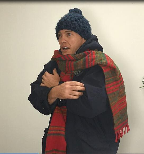 Video still - Our director Luke wearing 'insulation' - jacket, scarf and beanie.
