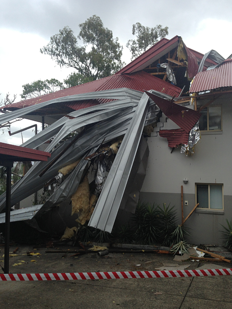 Twisted metal roof sheets removed during storm